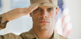 US soldier saluting flag..